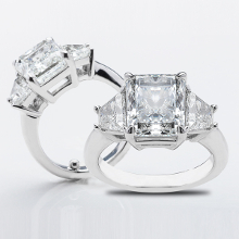 Three stone custom design engagement ring with 4.00ct Radiant diamond center stone and trapezoid diamonds on the sides